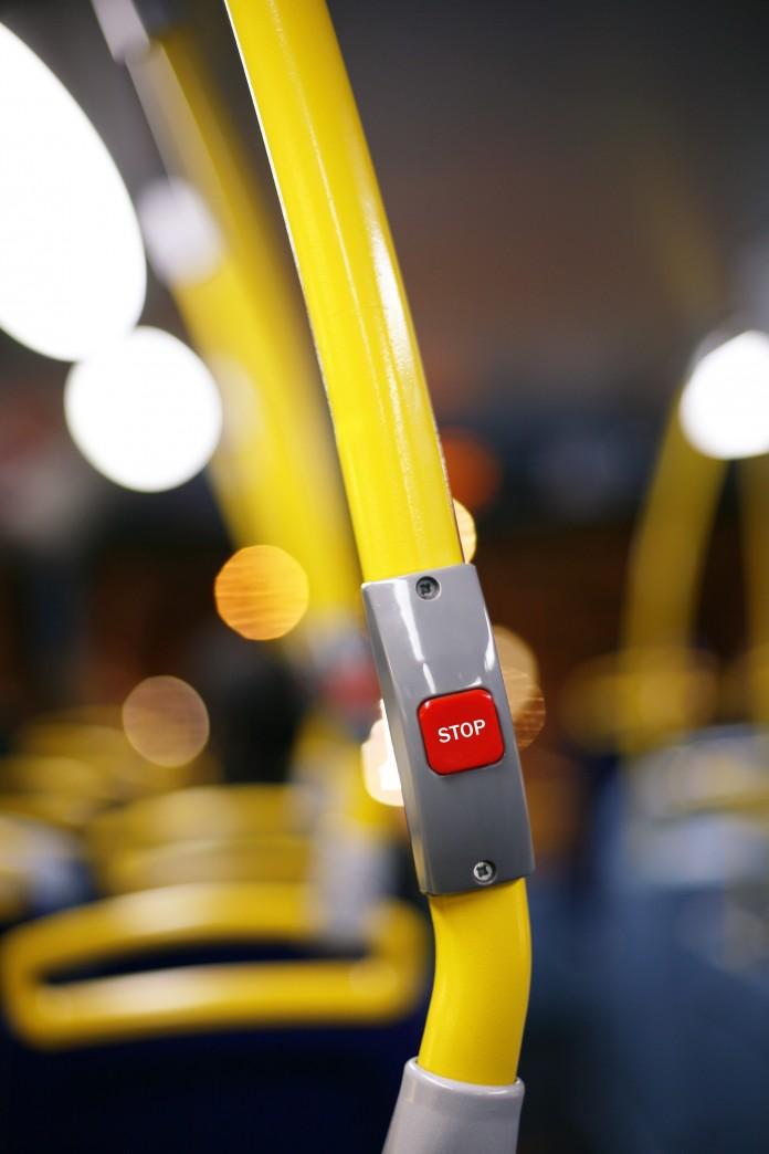 Stop-Knopf im Bus